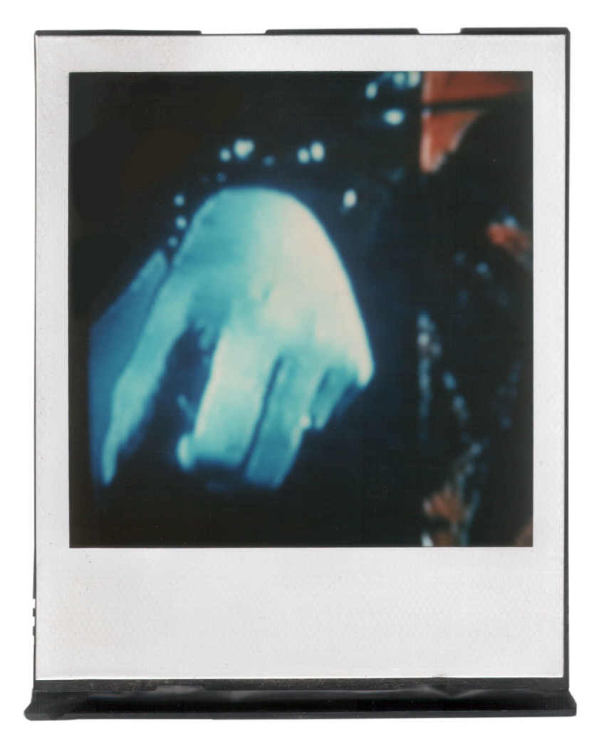 André Werner, untitled (hand cuffed), polaroid SX 70, 1986, 8,8 cm × 10,7 cm | 3,5″ x 4,2″ (image 7,9 cm × 7,9 cm | 3,1″ x 3,1″) mounted on SX70 polaroid cartridge.